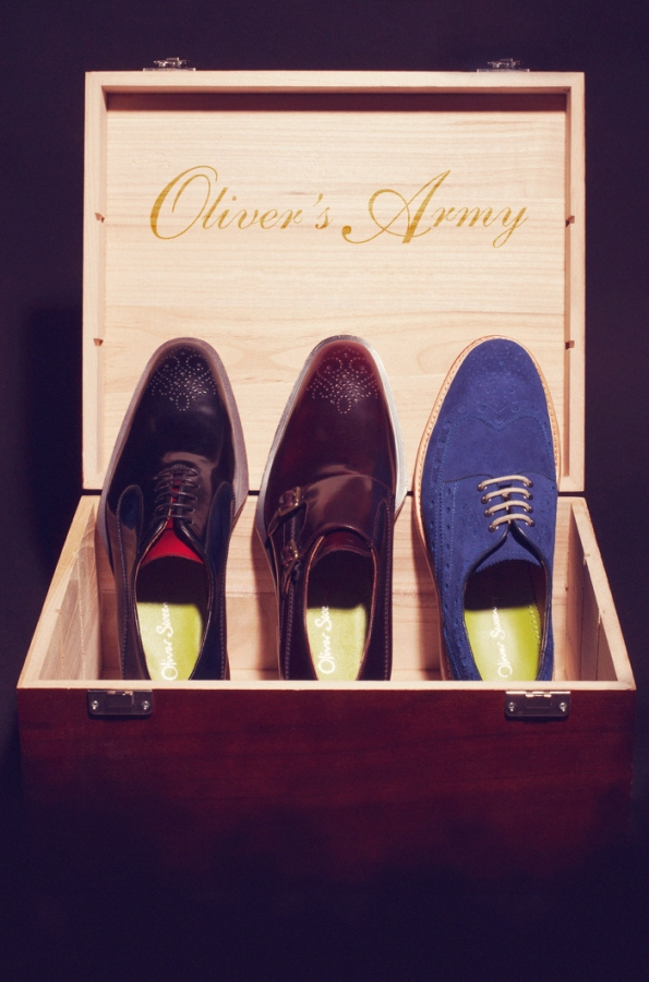 Three Oliver Sweeney brogue shoes in a box